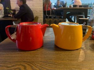 red and yellow teapot