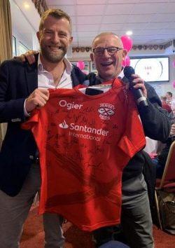 Simon presented with his shirt