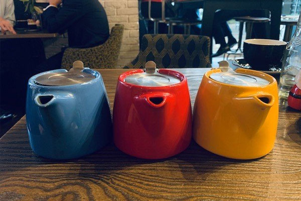 blue, red and yellow teapots